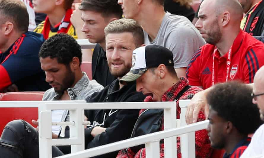 Mohamed Elneny (left) and Shkodran Mustafi (centre) in the stands during Arsenal's win over Burnley last Saturday.
