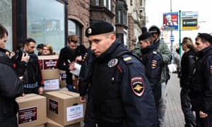 Police in Moscow surround activists and boxes containing petitions calling for an inquiry into a violent crackdown on gay people in Chechnya.