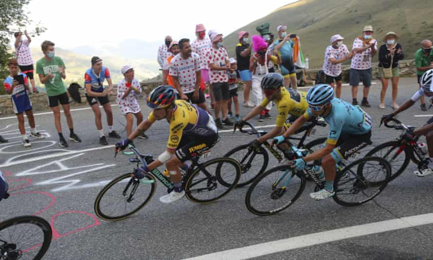 Adam Yates in the leader's yellow jersey on the Peyresourde pass.