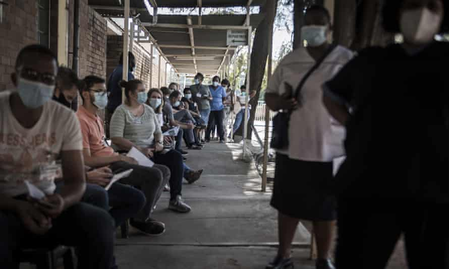 Healthcare workers queue to receive a Johnson & Johnson vaccine at the government hospital in Klerksdorp, South Africa