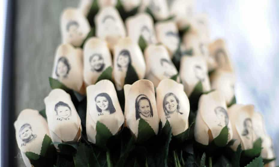 White roses bearing the faces of victims of the Sandy Hook Elementary School shooting.