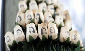 White roses with the faces of victims of the Sandy Hook elementary school shooting are attached to a telephone pole near the school in Newtown, Connecticut.