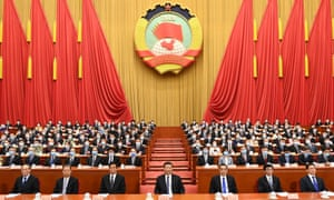 Li Keqiang (front row, third from right) with Xi Jinping (centre) at the opening of the national congress in Beijing on Friday.