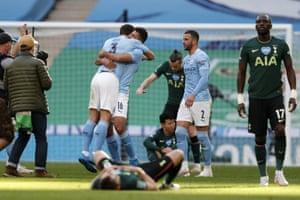 Manchester City's Rodrigo and Ruben Dias celebrate at the end of the match.