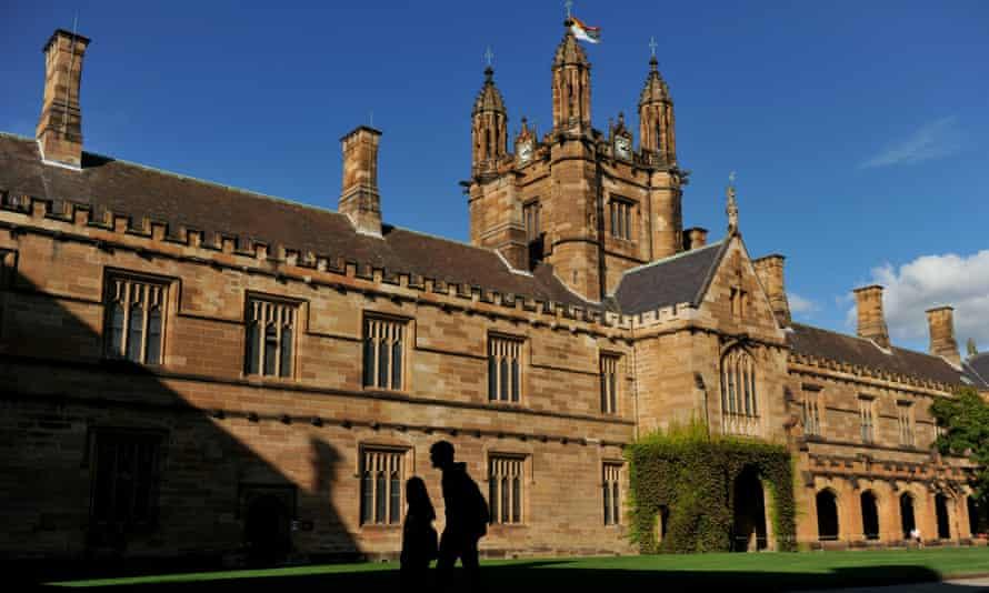 Students walk through The Quadrangle at The University of Sydney.