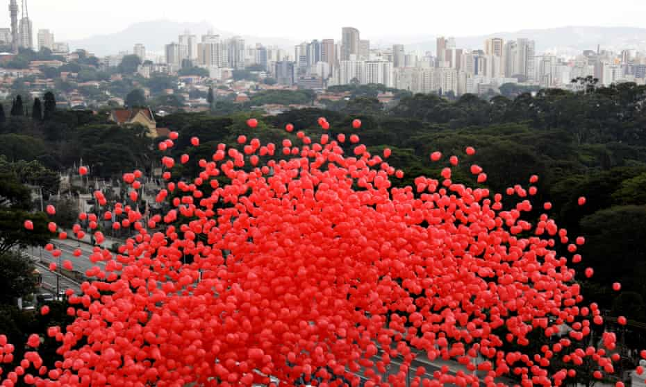 Red balloons are released to mark World Aids Day in São Paulo, Brazil yesterday.