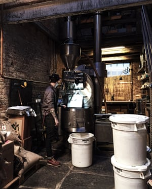 A man stands by the roasting machine at the Da Matteo Roastery and bakery in Gothenburg, Sweden.