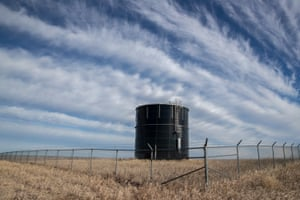 A Mni Wiconi water tank sits on a hill above Kyle, South Dakota, on the Pine Ridge Indian Reservation