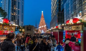 Christmas decorations festoon a street in Shanghai, but at least four Chinese cities and one county have banned such decorations.
