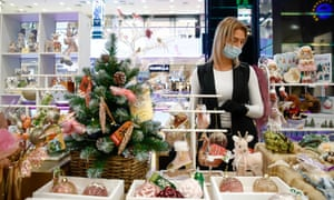 A shop assistant sells Christmas decorations at the Yevropeisky shopping center in Russia.