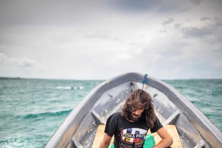 Behrouz Boochani on a small boat.