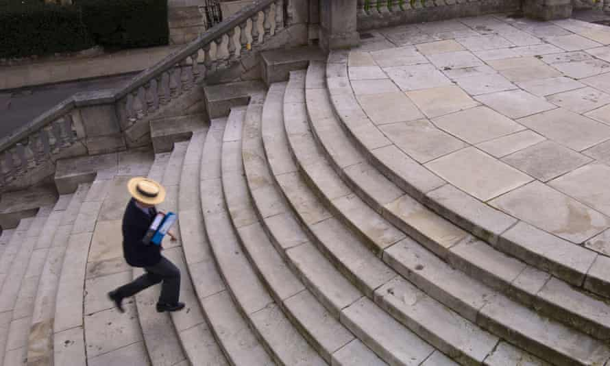 Student on the way to lessons on steps at Harrow school