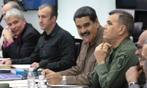 President Nicolás Maduro, second right, participates in a cabinet meeting in ministers in Caracas last week. Active duty or retired military officers make up nearly half of Maduro's cabinet.