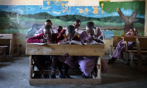 Masai children studying in a classroom of Nkoilale Primary School in Narok district, Kenya.