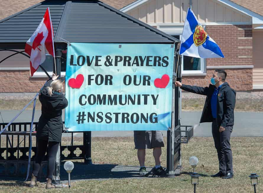 Workers at a care facility show their community support in Debert, Nova Scotia, after 22 people were killed in a mass shooting over 12 hours this weekend.