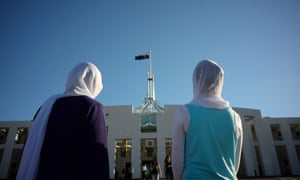 Afghan visitors wearing hijabs outside Parliament House in Canberra