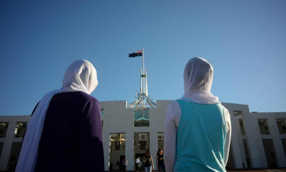 Visitors of Afghan nationality outside Parliament House in Canberra