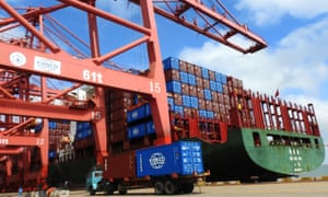 A truck transports containers at a port in Lianyungang in China's eastern Jiangsu province