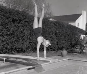 Doris Day diving into a pool in LA in 1950