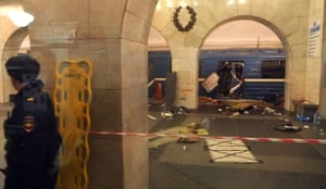 A picture taken from across the platform shows the damaged train carriage