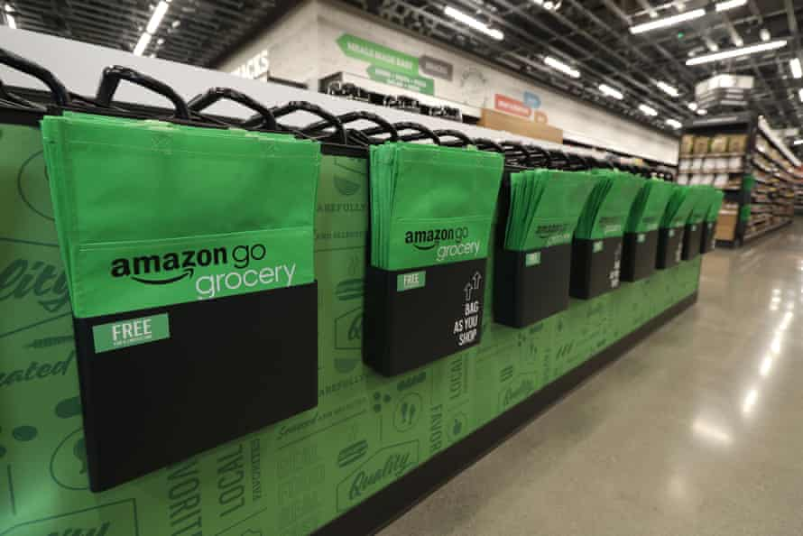 Inside Amazon's new grocery store are reusable bags and tables meant for mid-shop sorting.
