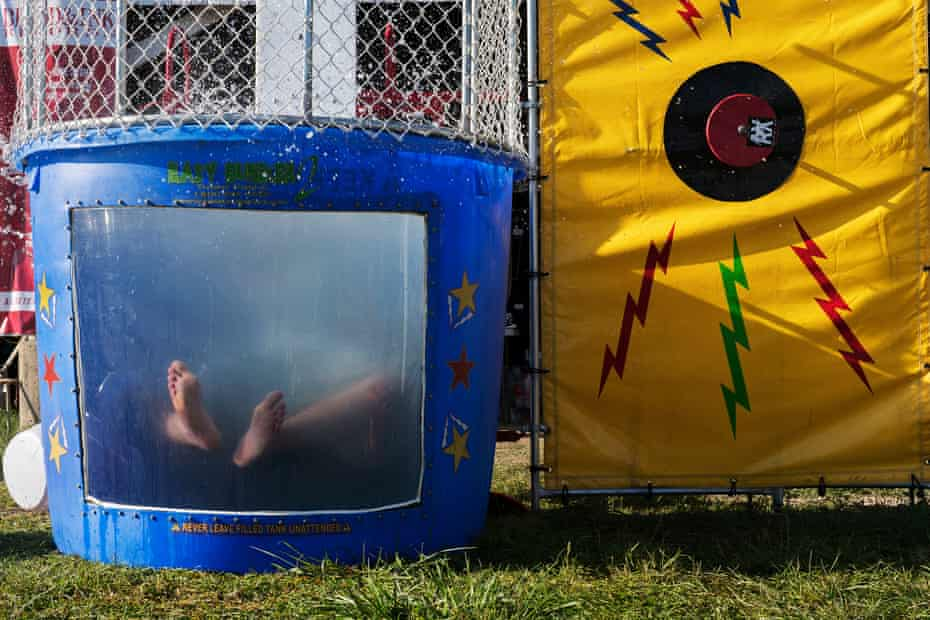 A member of the Blood & Ink record label gets dunked in a dunk tank.