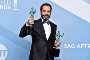 Tony Shalhoub poses in the press room with the trophies