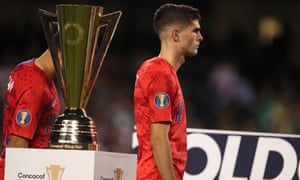 Christian Pulisic walks past the Gold Cup trophy after the US lost to Mexico in Sunday's final