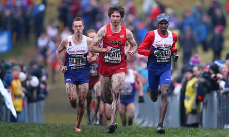 Garret Heath, of the US, leads Mo Farah, right, to win the senior men's 8Km during the Great Edinburgh XCountry on January 9 2016