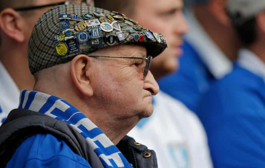 A Sheffield Wednesday fan shows his loyalties at last season's Sheffield derby at Hillsborough.