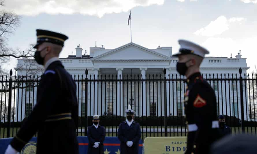 Members from all of the services of the US military march in front of the White House ahead of Joe Biden's inauguration in Washington DC on 18 January 2021.