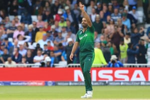 Pakistan's Wahab Riaz celebrates after taking the wicket of England's Chris Woakes.