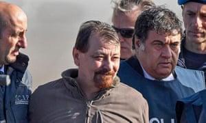 Cesare Battisti escorted by Italian police at Rome's Ciampino airport