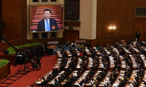 A live image of Xi Jinping on a screen above delegates at the national people's congress in Beijing.