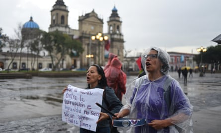 Protesters demonstrate in Guatemala City on Tuesday against President Jimmy Morales after he banned the chief of the UN's anti-corruption commission from entering the country.