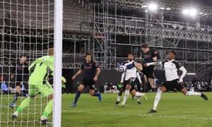 Manchester City's John Stones scores their first goal.