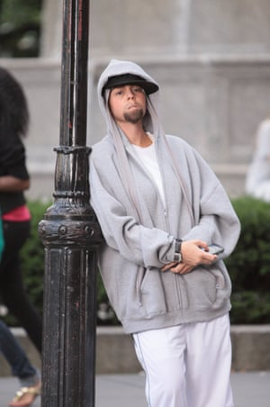 In his recent track 'Bagpipes From Baghdad' Eminem made a number of unflattering references to Mariah and her husband Nick Cannon. The singer's imitation of him in her video is reportedly in response to this lyrical attack.