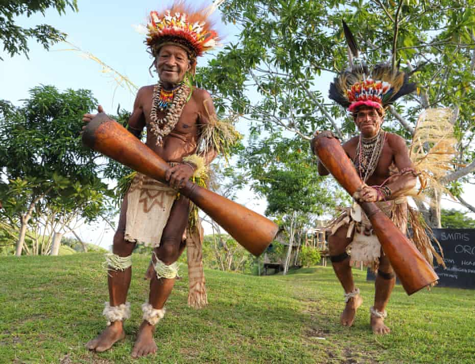 Smith and his dad perform a welcome dance on their Papua New Guinea island.