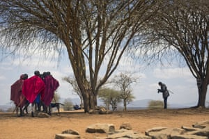 Maasai men converse under a tree after they cast their ballots in Eseki, 85 miles south of Nairobi