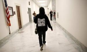 woman wearing 'flint lives matter' sweater