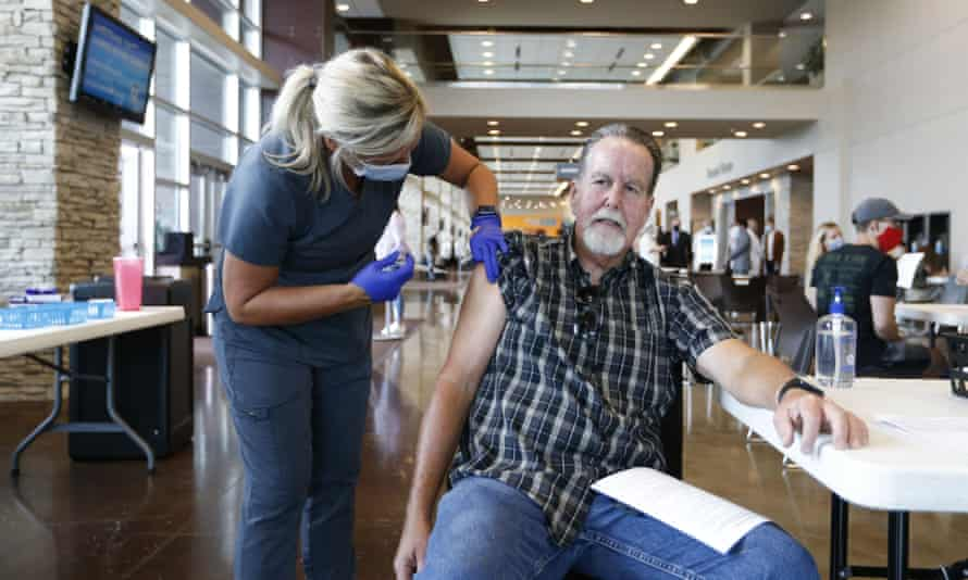 A vaccination event in Missouri. More than 856,000 doses were reportedly administered on Friday, the highest daily figure since 3 July.