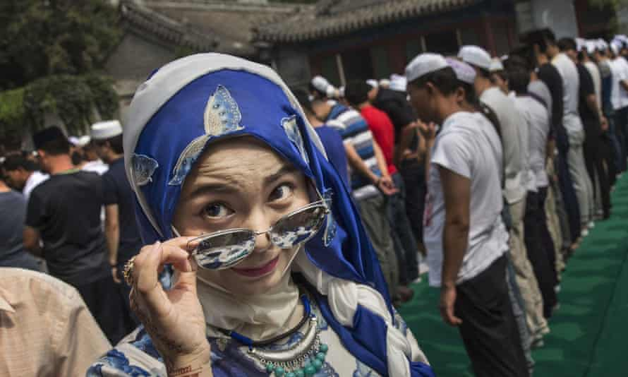 A Chinese Hui Muslim woman arrives for prayers at a Beijing mosque