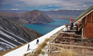 Southern comfort … Snowboarders and skiers at a lunch chalet above Lake Ohau, South Island, New Zealand.