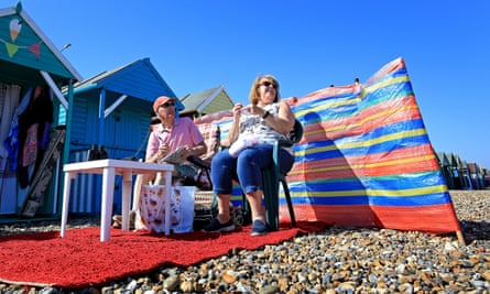 Alan and Daphne Smith enjoy the weather outside their beach hut in Herne Bay, Kent