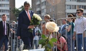 Secretary of State John Kerry lays flowers outside the French Embassy in Moscow in tribute to the victims of the deadly attack on Nice.