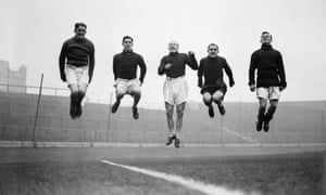 Alex Cheyne (second right), jumping with Chelsea teammates in 1932, was among the players brought in at great expense.