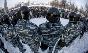 Police block a protest against the jailing of opposition leader Alexei Navalny in Yekaterinburg, Russia, Saturday, Jan. 23, 2021. Russian police on Saturday arrested hundreds of protesters who took to the streets in temperatures as low as minus-50 C (minus-58 F) to demand the release of Alexei Navalny, the country's top opposition figure. A Navalny, President Vladimir Putin's most prominent foe, was arrested on Jan. 17 when he returned to Moscow from Germany, where he had spent five months recovering from a severe nerve-agent poisoning that he blames on the Kremlin. (AP Photo/Anton Basanayev)