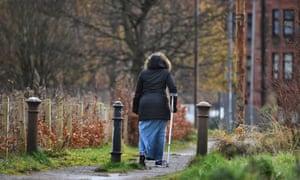 Women on crutches, Scottish housing estate