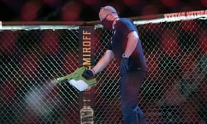 A worker sprays sanitiser in the octagon between bouts at a UFC event in Florida on Saturday.
