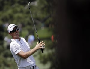 Justin Rose watches his shot fly on the 17th